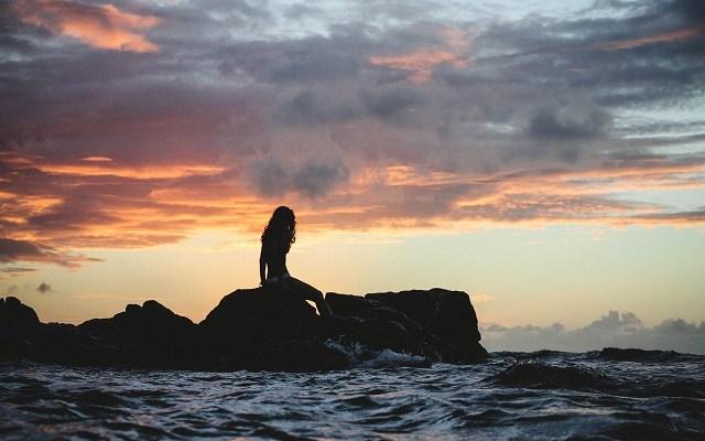 Mermaid-on-rocks-by-the-shore