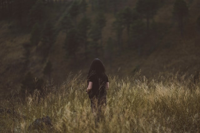 Faceless woman in the woods