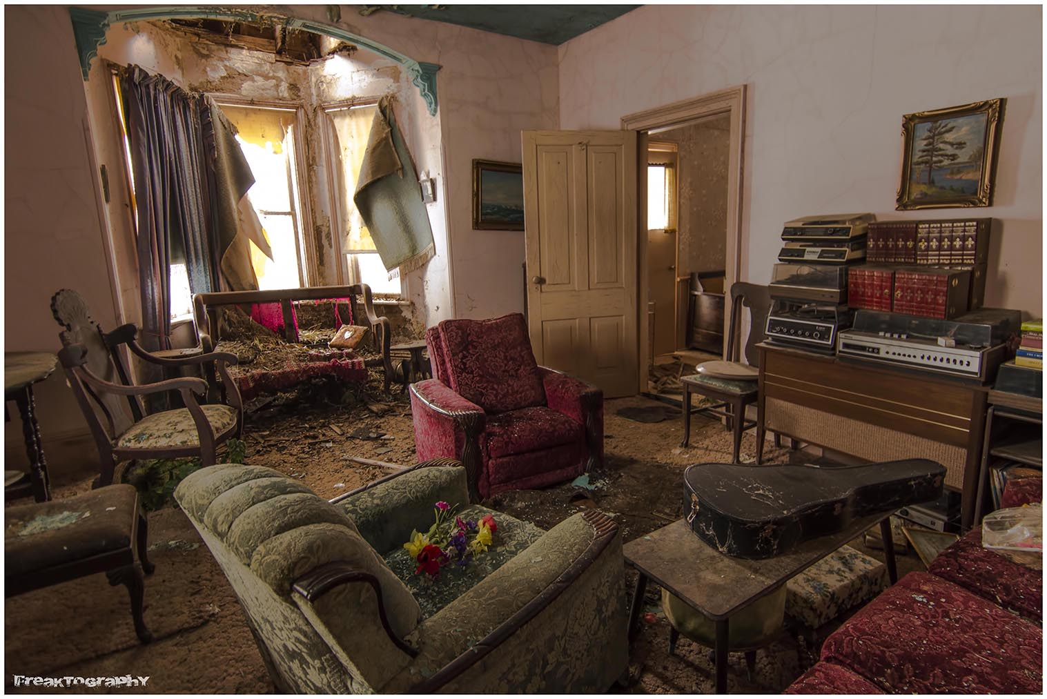 A Red Couch And Two Plush Chairs Were The Main Pieces Of Furniture, Along  With A Very Heavy Wooden Table And Chair Set In A Corner. As With The Other  Room, ...