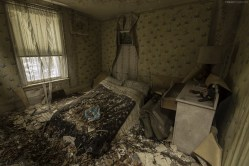 In an abandoned huse that has begun crumbling into itself, here is one of the upstairs bedrooms.