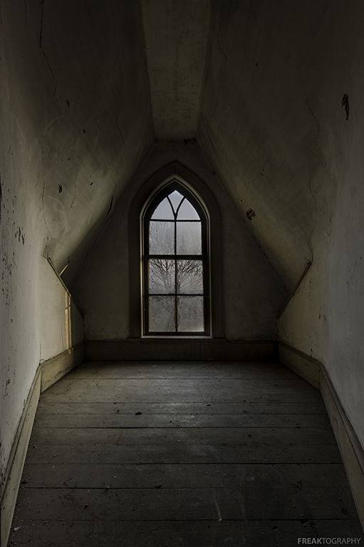 The attic window in an abandoned house in Ontario Canada.