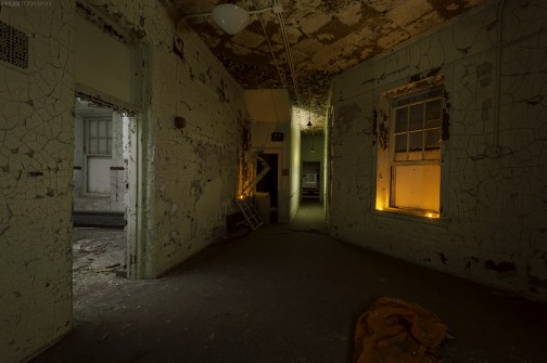 Getting creative with light in the pitcc black hallways of an abandoned insane asylum.