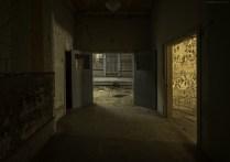 The doorway into the mens solarium in an abandoned insane asylum in Ontario.