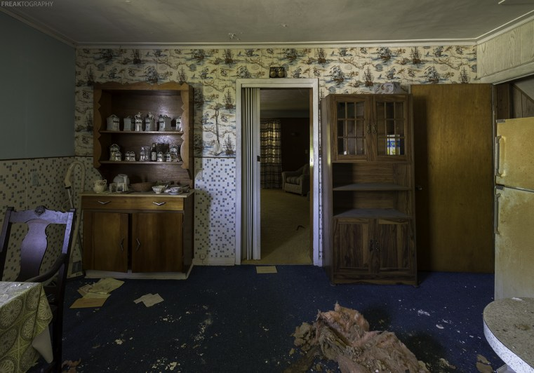A mostly still in tact but water damaged kitchen in an abandoned