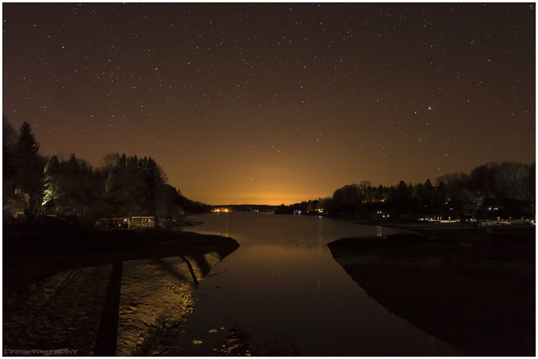 Starry sky over Rushford Lake, New York.