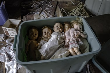dolls in an abandoned house attic