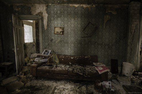 Badly decaying living room in an abandoned house