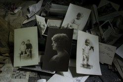 Dozens of old photos were found spread around the floor in an upstairs room in this abandoned house in Ontario.