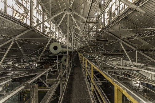 Up in the rafters in an abandoned automotive plant.