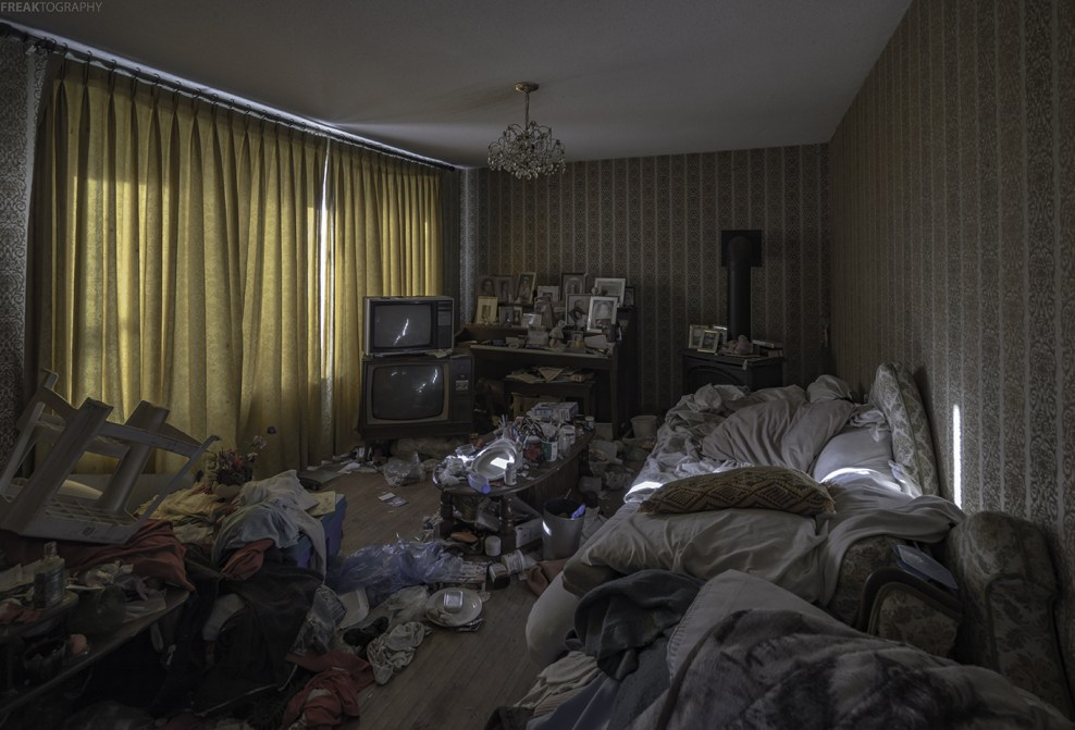 An interesting abandoned house in rural Ontario. Every room is packed with hoarded items, the basement is flooded and there are cobwebs at every doorway.