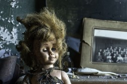 A Chatty Cathy doll in a bedroom of an abandoned house