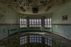 Windows and reflections in Abandoned Psychiatric Hospital