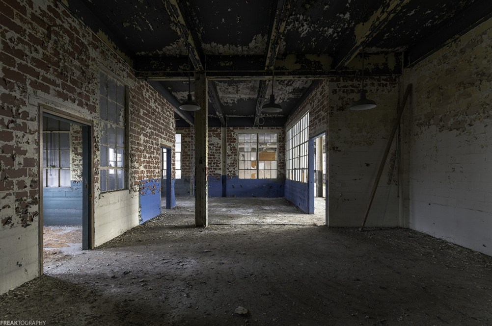 Exposed brick and supporting beams in an old industrial lot in Ontario