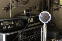 Inside a fully in tact abandoned house is this CB Radio station, hidden behind piles of clothes and boxes. A very cool find indeed!