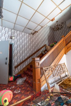 abandoned 1980s hotel stairs