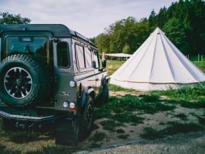 Land Rover Defender at the tent