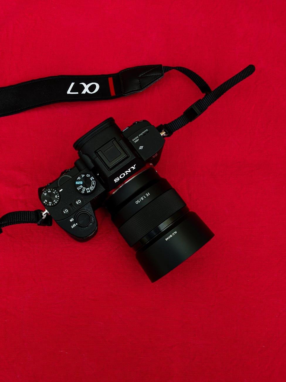 black digital camera on red background