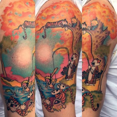 half-sleeve-mens-calvin-and-hobbes-themed-tattoos