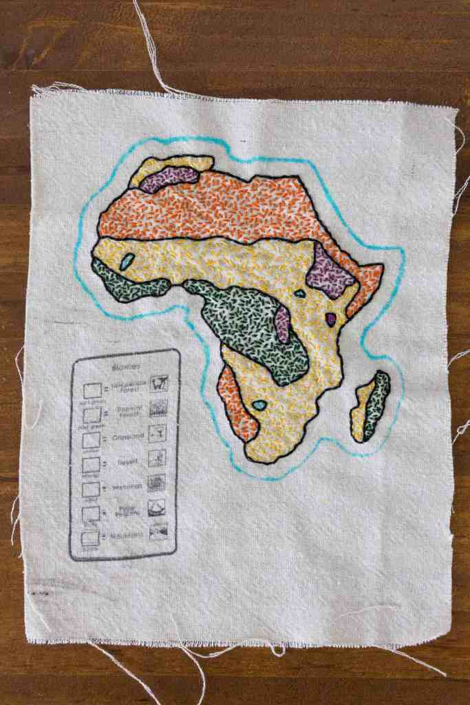 The map of the biomes of Africa has been embroidered and is now ready to be cut out. You can download biome map templates from Waseca Biomes.
