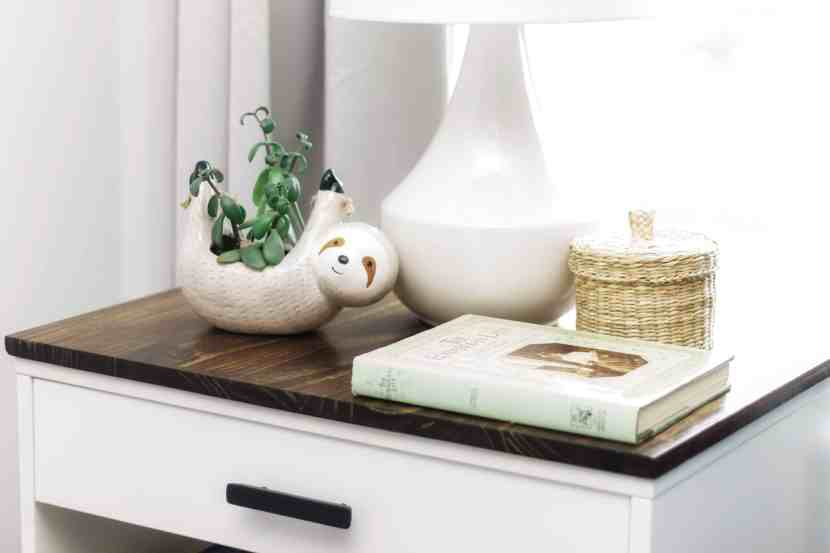 A close-up picture of IKEA's VIKHAMMER nightstand that has been transformed to fit into a modern farmhouse-inspired bedroom.