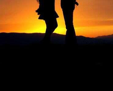 Boy and Girl Silhouetted In the Evening