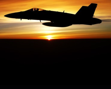 Fighter Jet Silhouetted At Twilight