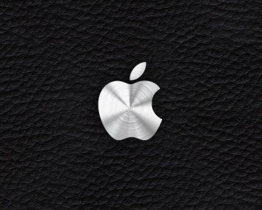 Silver Apple Logo With Leather Background