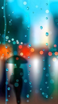 Woman Silhouetted In The Rain