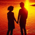 Couples Silhouette On The Beach