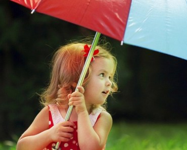 Cute Baby With Colorful Umbrella