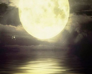 Yellow Moon Over The Sea