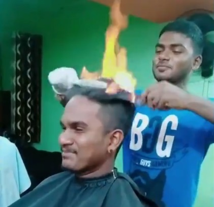 This Barber Will Cut Your Hair But Sets It On Fire First