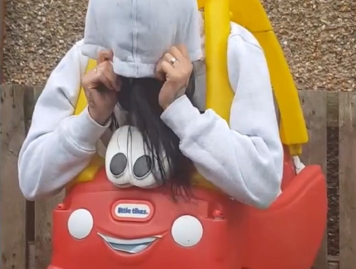 Woman Gets Stuck in A Plastic Toy Car, Then Cut Out With A Bread Knife