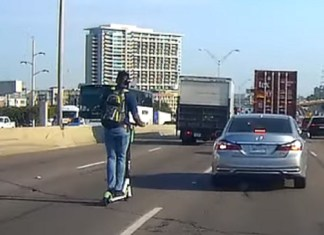 Guy Rides Electric Scooter Down The Highway