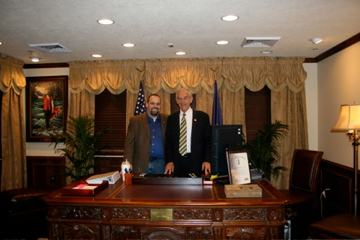 Rick Koerber and Presidential Candiate Ron Paul, at Rick's Office behind the President's Desk