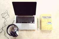 laptop with headphone to eliminate conference call echo