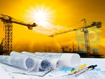 Plant On Working Table And Crane Construction Background