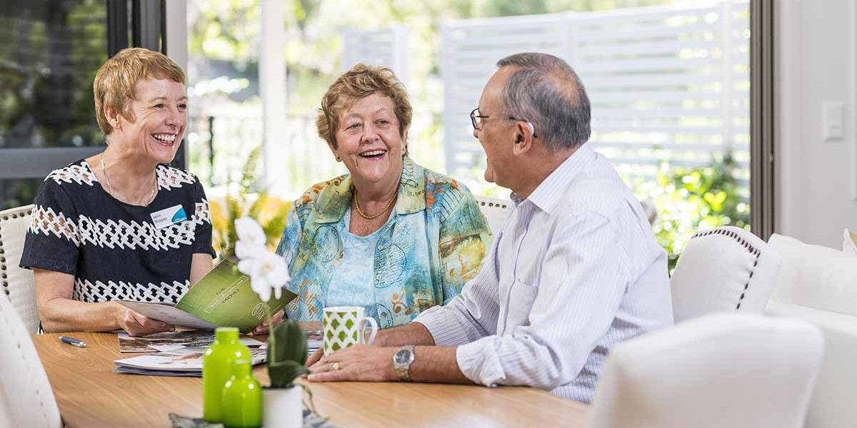 staff_durack_retirement_community_manager_sitting_with_couple_1200x900