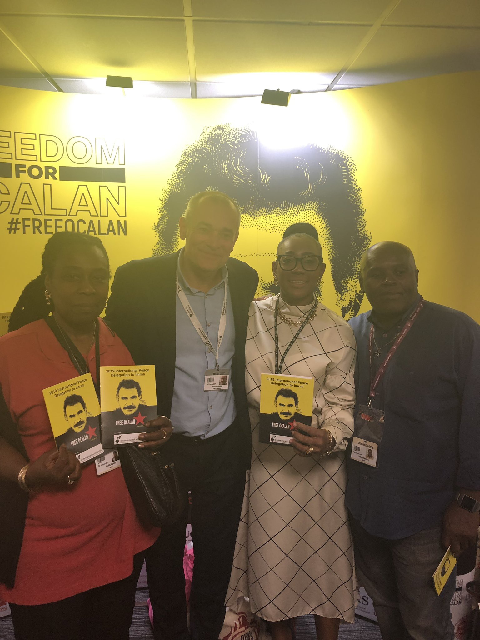 Unite the Union BAEM Committee holding placards calling for Freedom for Ocalan at TUC congress 2019