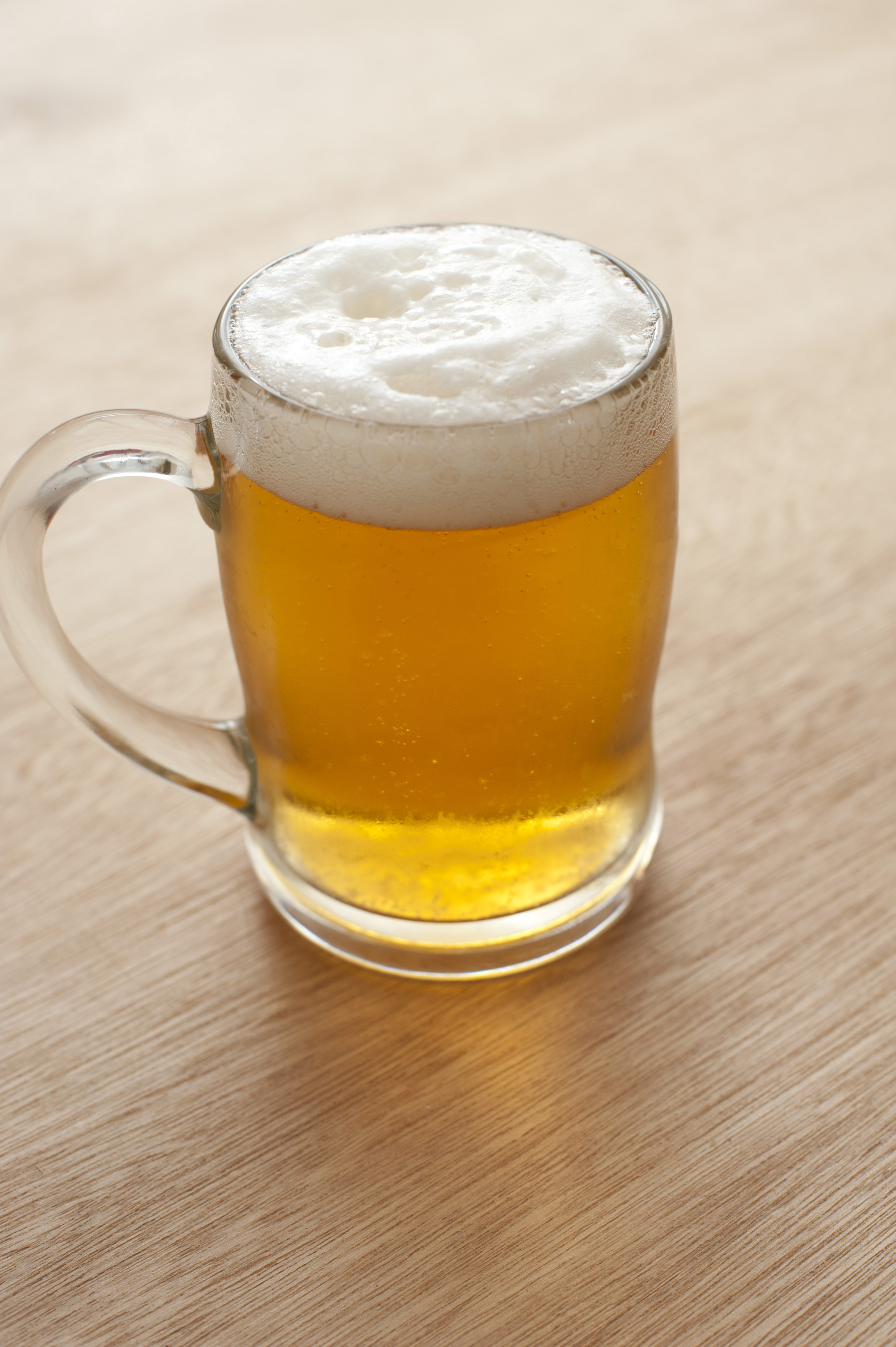 Tankard of beer with a frothy head  Free Stock Image