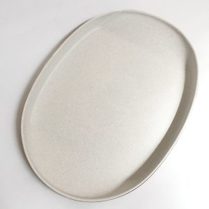 view from above of matte white glazed large serving platter