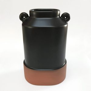 matte black oval vase with unglazed base and small round design on top sides
