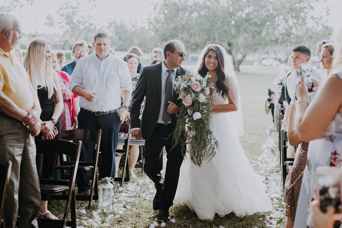 bride walking down the aisle | boho bride | romantic sarasota wedding photographer | romantic sarasota wedding | tampa wedding photographer | freehearted film co