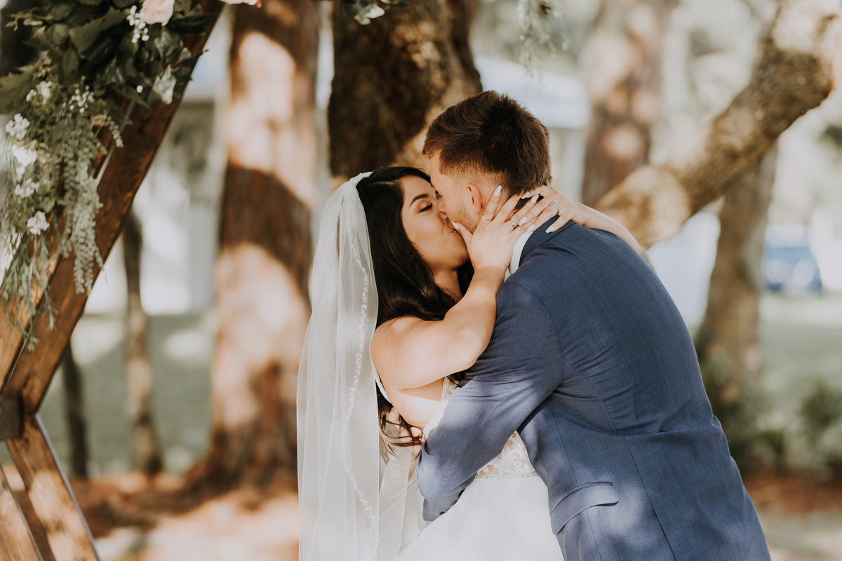 first kiss | boho wedding | romantic sarasota wedding photographer | romantic sarasota wedding | tampa wedding photographer | freehearted film co