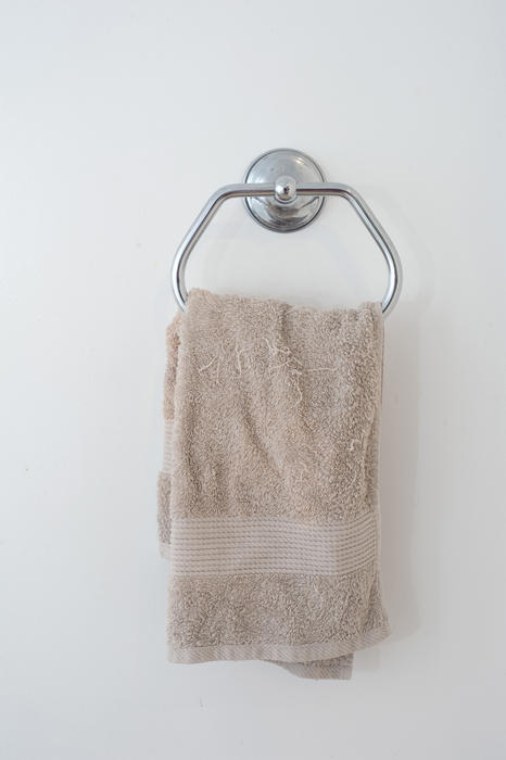 Free Stock Photo 6923 Beige hand towel hanging in a