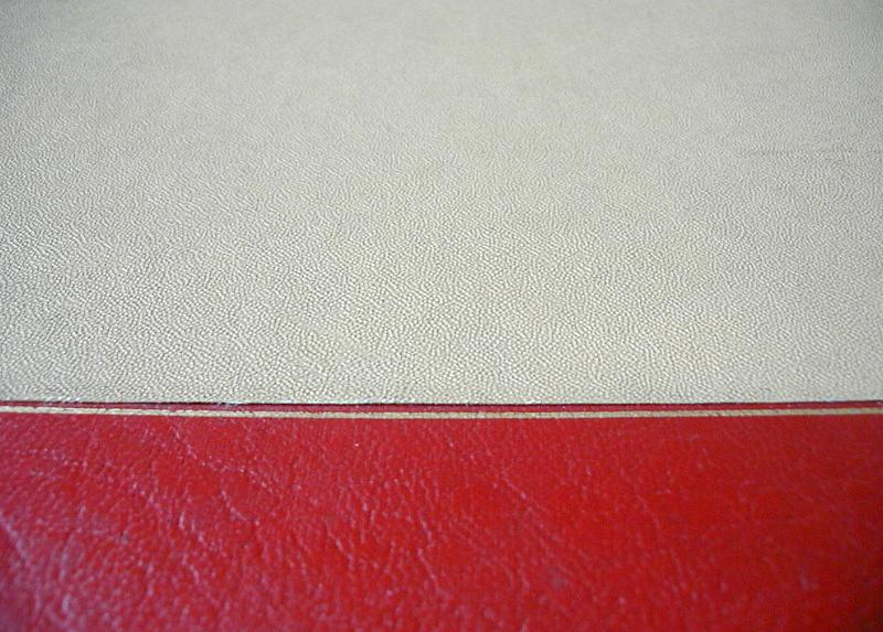 Free Stock Photo: Top down close up on red and white book cover with fine leather type texture and copy space