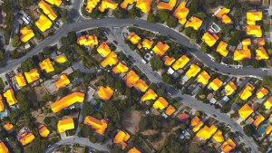 Rows of houses in a neighborhood with their roofs highlighting where the sun shines on them