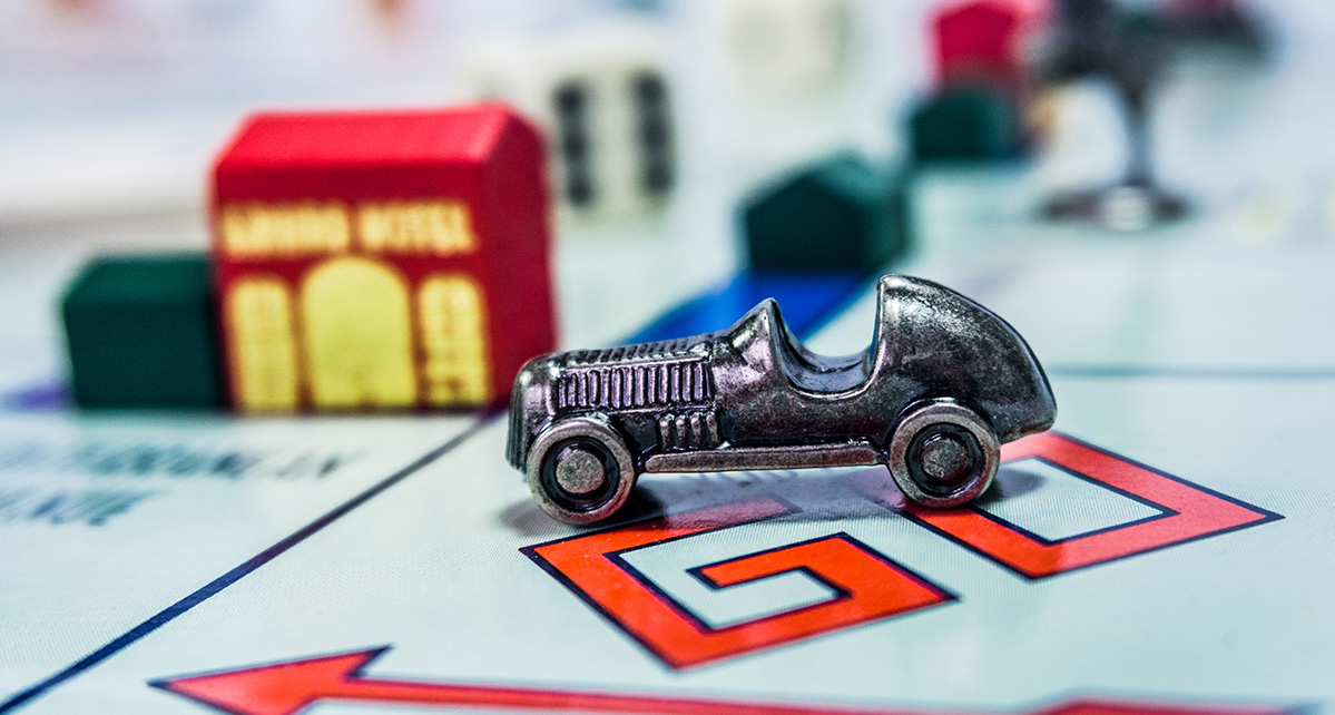 EV Electric Car on a monopoly board game