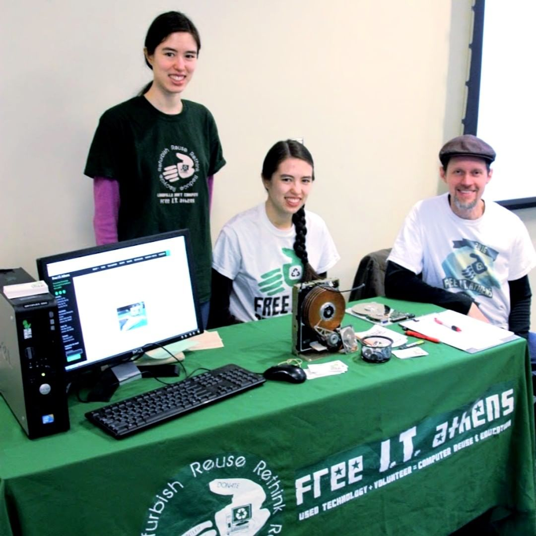 Three volunteers behind an information table