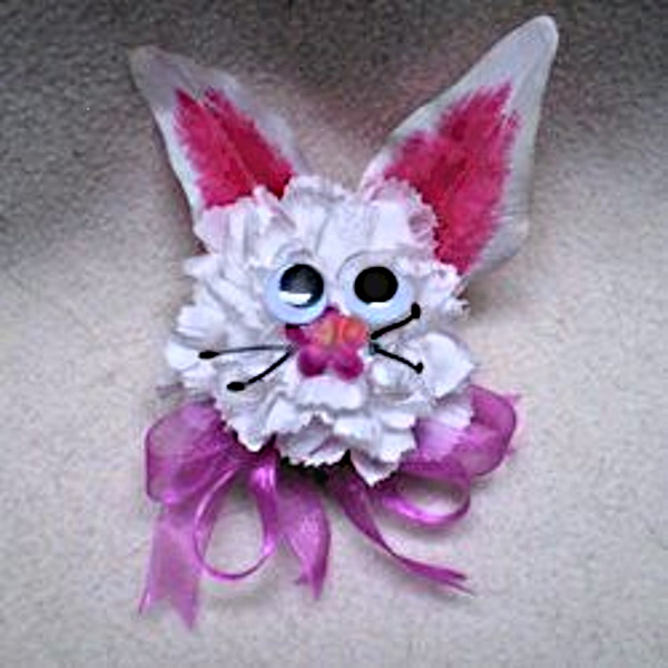 bunny corsage made with artificial flowers.